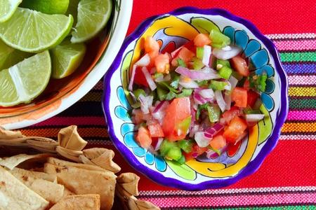 totopos: Pico de gallo tomato and chili Mexican sauce serape tablecloth Stock Photo