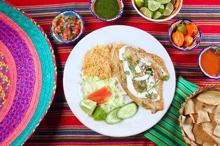 mojo: fish fillet al mojo de ajo with garlic sauce chili sauces Mexican spiced food