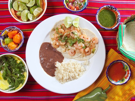 shrimp tacos rice and frijoles chili sauces Mexican seafood photo