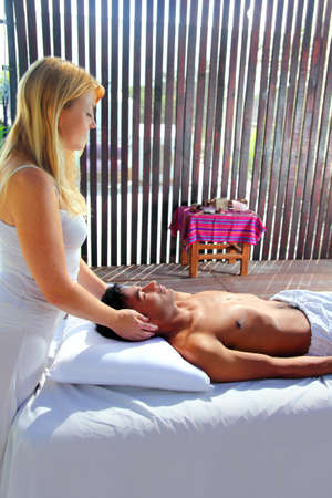 sacral: cranial sacral massage theraphy in Jungle cabin tropical rainforest Stock Photo