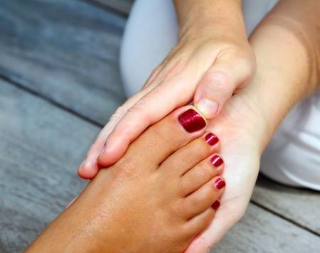 massage hands: Reflexology woman feet massage therapy outdoor Stock Photo