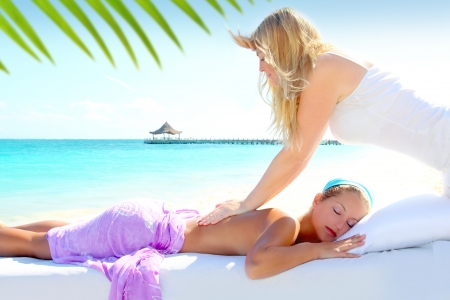 Caribbean turquoise beach chiropractic massage therapy woman  Stock Photo