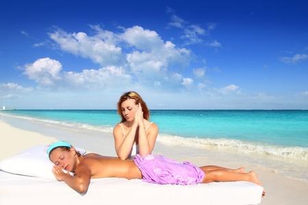 massage meditation shiatsu elbows pressure Caribbean beach woman Stock Photo - 9120741