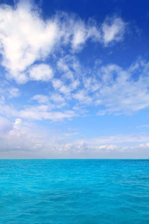 Caribbean sea horizon blue sky clouds Mexico seascape photo