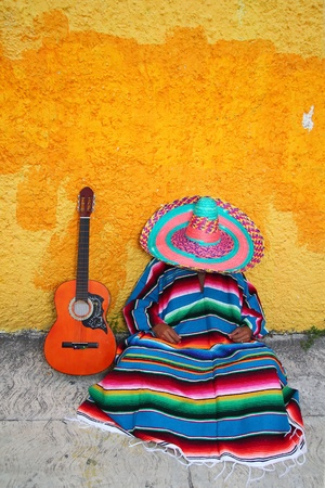 pregui�oso: Mexican typical lazy man sombrero hat guitar serape nap siesta