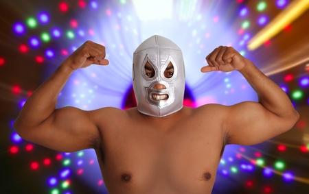 wrestling: mexican wrestling mask silver fighter gesture night lights blurred
