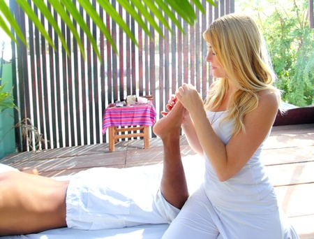 reflexology massage therapy physiotherapy in jungle cabin digital pressure photo