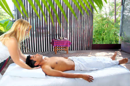 sacral: cranial sacral massage therapy in Jungle cabin tropical rainforest Stock Photo