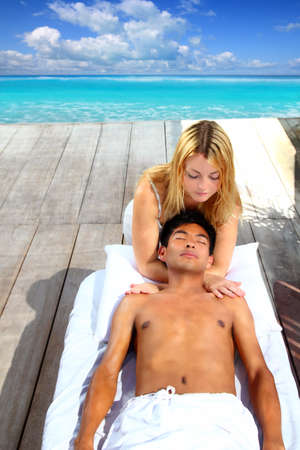 massage therapy stretch head neck outdoor Caribbean beach Stock Photo - 9142600