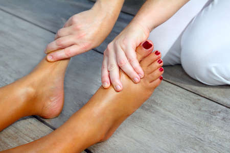 Reflexology woman feet massage therapy outdoor Stock Photo - 9142629