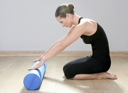 blue foam roller pilates woman sport gym fitness yoga wood floor Stock Photo - 9142314