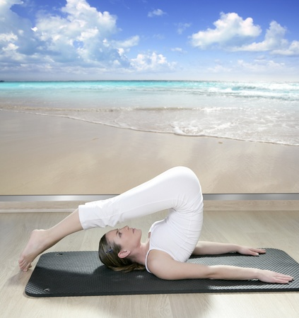 black mat yoga woman window view of tropical beach caribbean sea photo