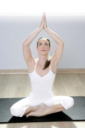 yoga woman fitness girl in white meditation at gym on mat photo