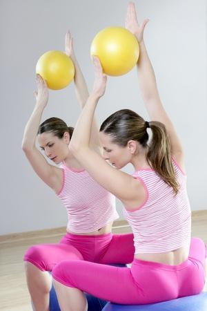 mirror pilates gym woman stability ball sport gym fitness girl photo