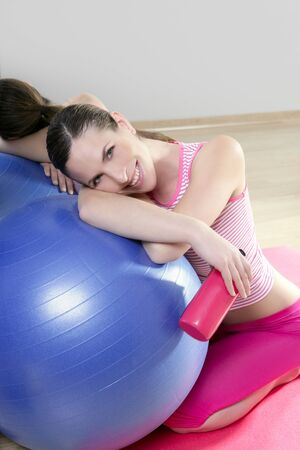 aerobics woman blue pilates ball relax water bottle smiling in sport gym mirror photo