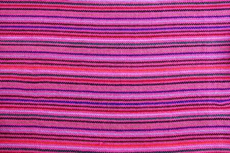 Mexican serape vibrant pink macro fabric texture background photo