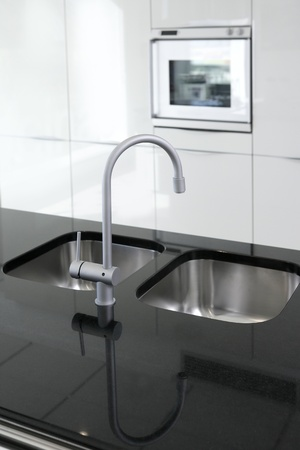 faucets: kitchen faucet and oven modern black and white interior design Stock Photo