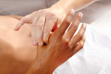 soothe: digital pressure hands reflexology massage tuina therapy physiotherapy Stock Photo