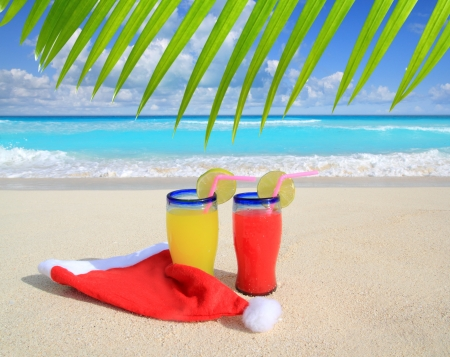 caribbean drink: Beach cocktails with Santa christmas red hat winter vacation metaphor