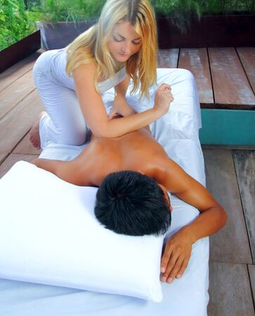 Mayan massage paravertebral therapy physiotherapy in jungle cabin latin and asian technics photo