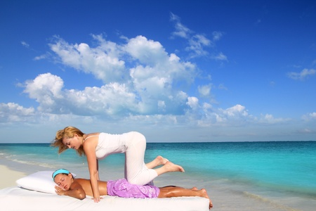Caribbean beach therapy shiatsu massage on knees women in paradise photo