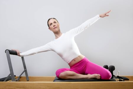 pilates reformer woman gym fitness teacher legs exercise Stock Photo