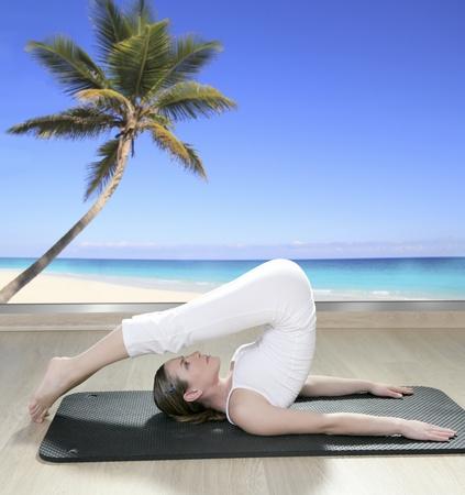 saxy: black mat yoga woman window view of palm tree beach tropical sea Stock Photo