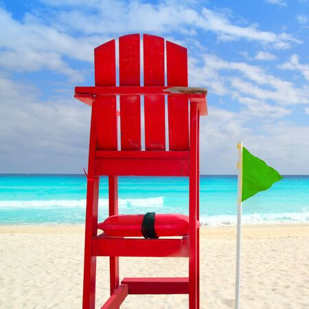 baywatch: Baywatch red beach seat green wind flag in tropical caribbean sea Stock Photo