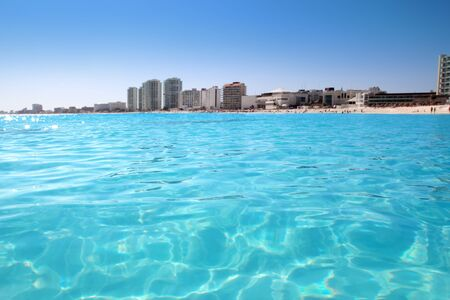 cancun: Cancun beach view from turquoise Caribbean water vacation destination