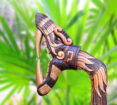 snake symbol: Chichen Itza Snake symbol wood handcraft figure in jungle Mexico Yucatan