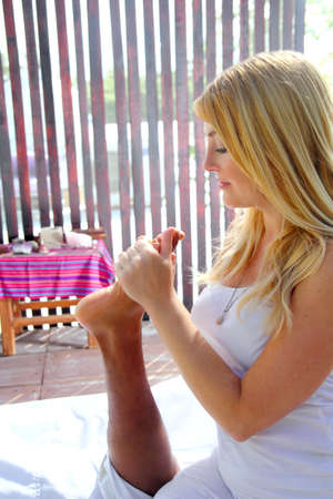 reflexology massage therapy physiotherapy in jungle cabin digital pressure Stock Photo - 9226882