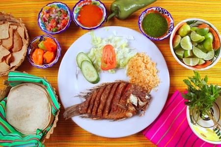mojo: fried mojarra tilapia fish Mexico style with chili sauce and nachos