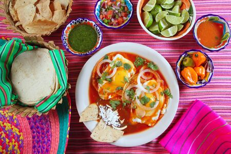 Breakfast Mexican ranchero eggs with chili and nachos Mexico flavor photo