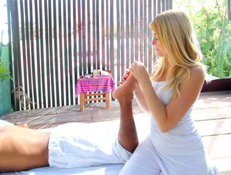 reflexology massage therapy physiotherapy in jungle cabin digital pressure Stock Photo - 9307568