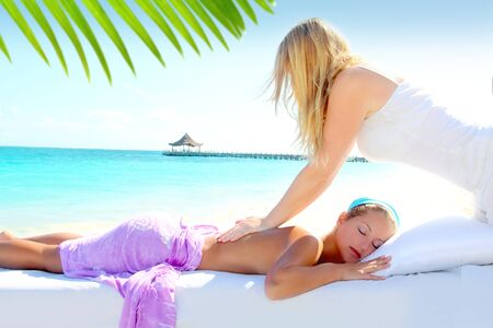 massage therapy: Caribbean turquoise beach chiropractic massage therapy woman  Stock Photo