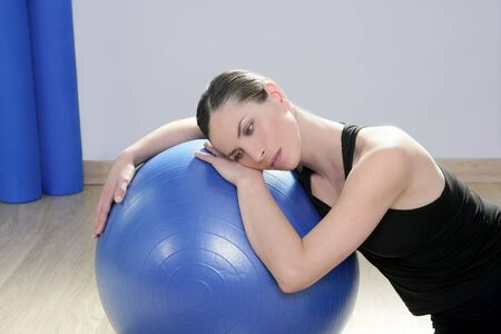 aerobics fitness woman relax pilates stability blue ball in sport gym photo
