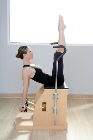 combo wunda pilates chair woman fitness yoga gym exercise Stock Photo