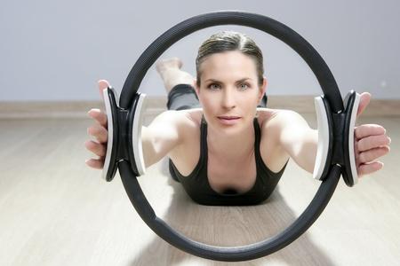 magic pilates ring woman aerobics sport gym exercises on wooden floor photo
