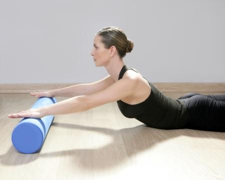 blue foam roller pilates woman sport gym fitness yoga wood floor photo