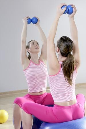 mirror pilates gym woman toning balls sport gym fitness girl photo