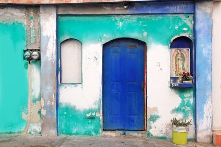 Mexican virgin madonna figure house facade tropical Caribbean Guadalupe Stock Photo - 9307866