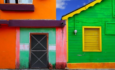 mujeres: colorful Caribbean houses tropical vivid colors Isla Mujeres Mexico Stock Photo