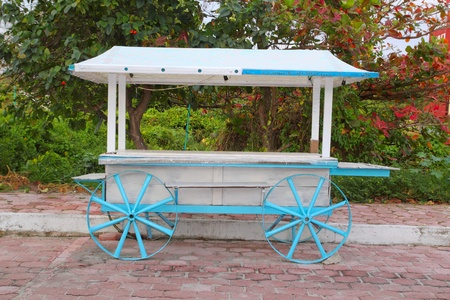 street vendor: Ice cream hot dogs cart white blue in Caribbean island Isla Mujeres Mexico Stock Photo