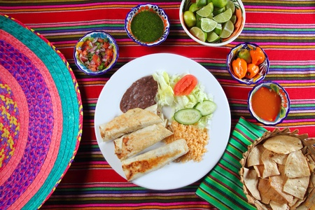 totopos: Burritos mexican rolled food rice salad and frijoles Mexico food Stock Photo