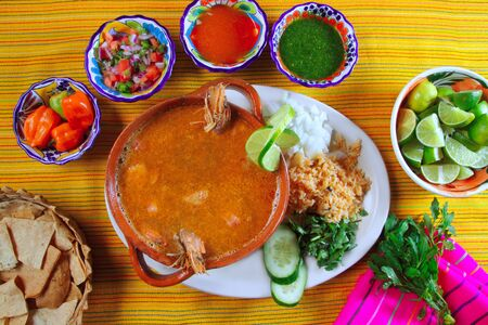 shrimp seafood soup mexican chili sauces and nachos photo