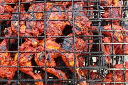 grilled chicken in red achiote sauce tikinchik Mayan Mexico recipe photo
