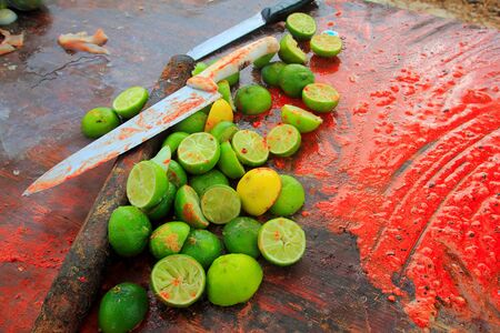 pungency: achiote knifes and lemons after preparinng achiote tikinchick Mayan sauce Mexico