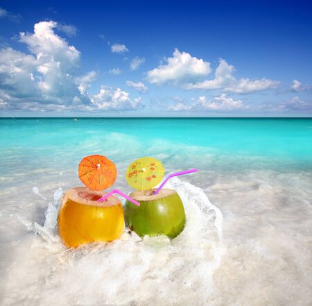 coconut cocktails juice in tropical beach water splash turquoise caribbean Stock Photo