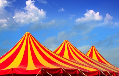 entertainment tent: Circus tent red orange and yellow stripped pattern blue sky