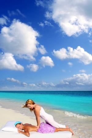 Caribbean beach massage shiatsu waist pressure woman outdoor paradise Stock Photo - 9410661